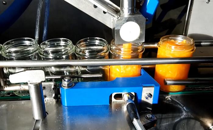 Fillpack - Doseuse pneumatique Dosup 1 tête, ligne confiture en bocaux verre